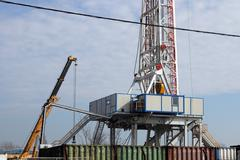oil drilling rig and crane - stock photo