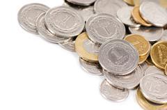 Many polish zloty coins lying on white - stock photo