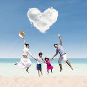happy family jumping under love cloud at beach - stock illustration