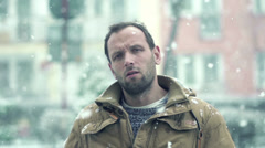 Sad young man in the city during blizzard, super slow motion, shot at 240fps HD Stock Footage