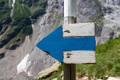 signpost on treks in switzerland - stock photo