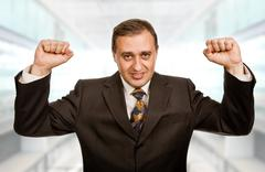 Successful business man with open arms at the office Stock Photos