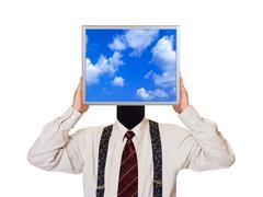 Businessman with sky computer screen - stock photo