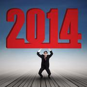 Young businessman is lifting new year 2014 Stock Illustration