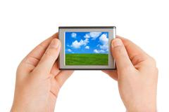 Screen with landscape in hands - stock photo