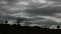 Dramatic, dark clouds. Field, countryside, farm. Stock Footage
