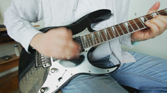 Guitar player playing electric guitar Stock Footage