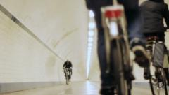 Cyclists Cycling By in Tunnel - 29,97FPS NTSC Stock Footage