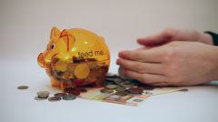 Piggy bank, hands counting money, coins, banknotes, cash Stock Footage
