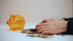 Hands dropping coins, counting money, piggy bank, fortune, cash Stock Footage