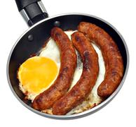 Frying Pan With Egg And Sausages - stock photo