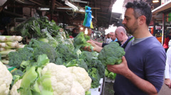 Buying broccoli and cauliflower Stock Footage