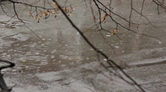 Rain falling on the street,droplets drops in the puddle, close up shot - stock footage