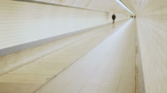 Solitary Man Walking in a Tunnel - 29,97FPS NTSC Stock Footage