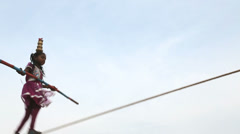 Young girl tightrope walker, Puducherry, India Stock Footage