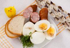 Eggs with bread and sausage Easter food Stock Photos