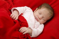 young baby sleeping, studio picture - stock photo