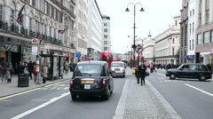 Taxis at shaftesbury avenue in london Stock Footage