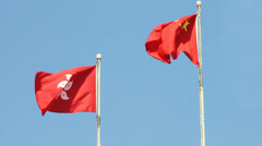 Flags of China and Hong Kong SAR waving in the wind Stock Footage