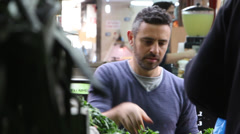 A handsome man buying healthy vegetables in the market Stock Footage
