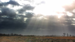 Stock Video Footage of God Rays clouds with sunbeams over countryside Time Laps