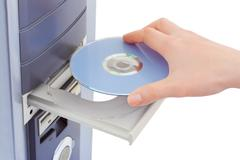 Hand and computer cd-rom Stock Photos