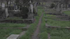Old haunted cemetery [flycam] uphill Stock Footage