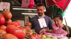 People buy fruits in the market Stock Footage