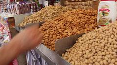 Man tasting almonds Stock Footage