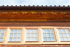 Windows of wooden log house Stock Photos