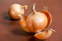 white onion with brittle and dry outer layers - stock photo