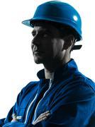 Man construction worker profile sideview silhouette portrait Stock Photos