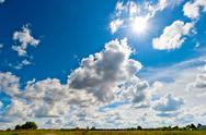 Stock Photo of bright rays of the sun over the yellowed field