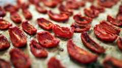 Dried tomatoes with olive oil and spices Stock Footage