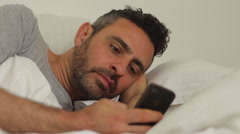 Using smartphone in bed Stock Footage