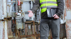 Electricians near old high voltage power divider - stock footage