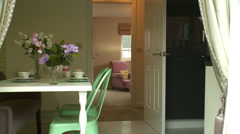 Track through dining room in modern home Stock Footage