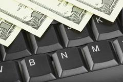 Computer keyboard and money - stock photo