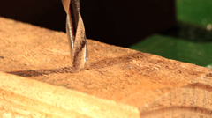 Drill machine making a hole in the wood. Manufacturing Stock Footage