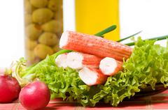 Crab sticks of surimi imitation on lettuce leaf Stock Photos