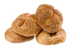 Baked graham kaiser rolls with spices and sesame Stock Photos