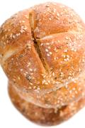 graham kaiser rolls with spices and sesame seeds - stock photo