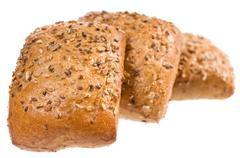 Fresh baked graham bread rolls with seeds - stock photo