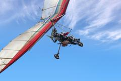 motorized hang glider - stock photo