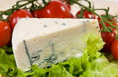Portion of blue cheese Roquefort - stock photo