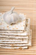 Many dried matza or matzah bread slices Stock Photos