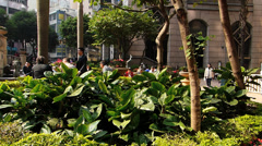 Having a break in the sun Hong Kong Central district China Asia Stock Footage