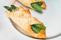 Pastry filled with asparagus and prosciutto Stock Photos