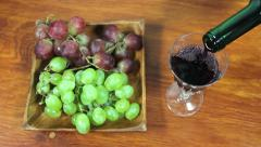 Pouring Red Wine Into A Glass. Grapes 2 Stock Footage