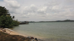 Scenic Changi Point Beach on a Cloudy Day in Singapore Panning 1920x1080 Stock Footage